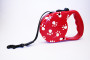 paw print retractable lead red